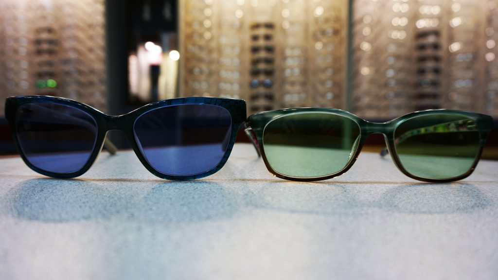 Dark blue vs light green tinted lenses
