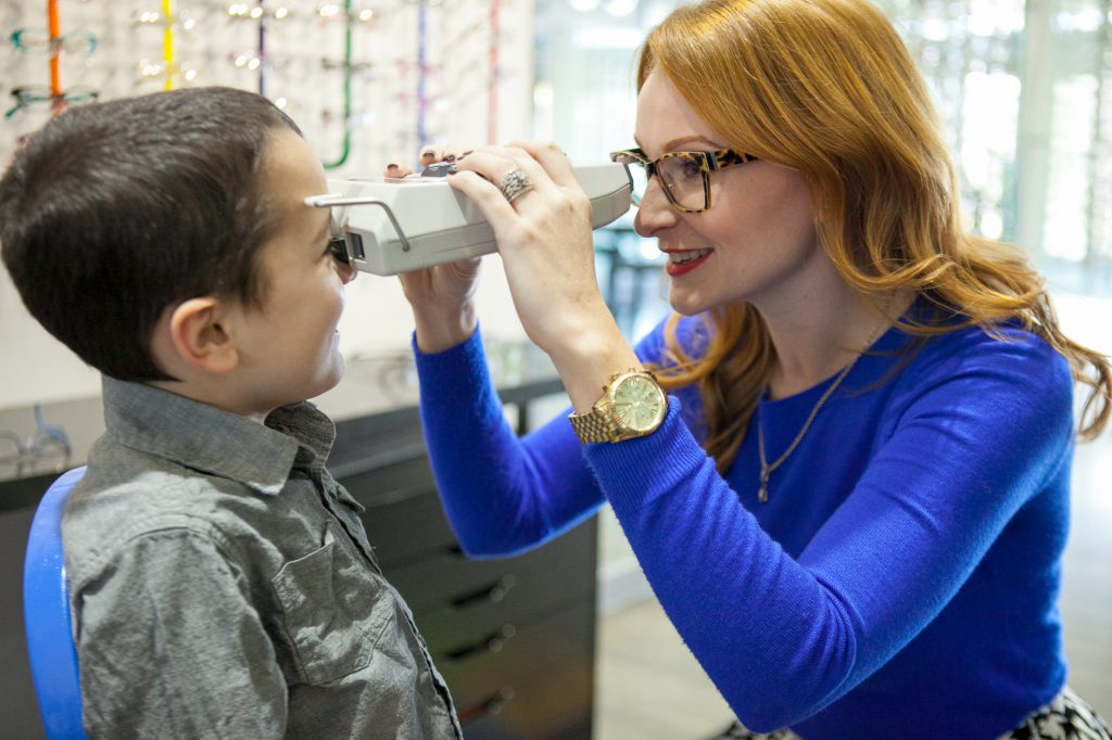 Optician taking a child's pupillary distance