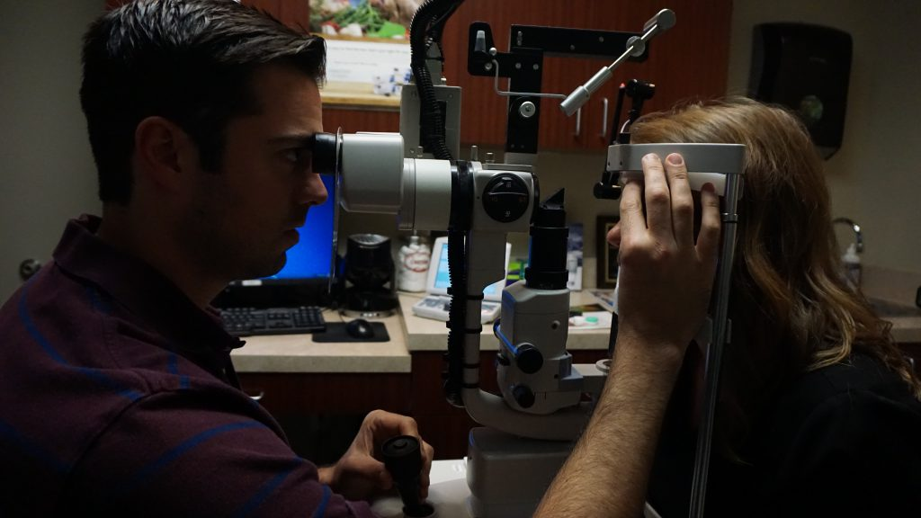 Eye doctor giving eye exam