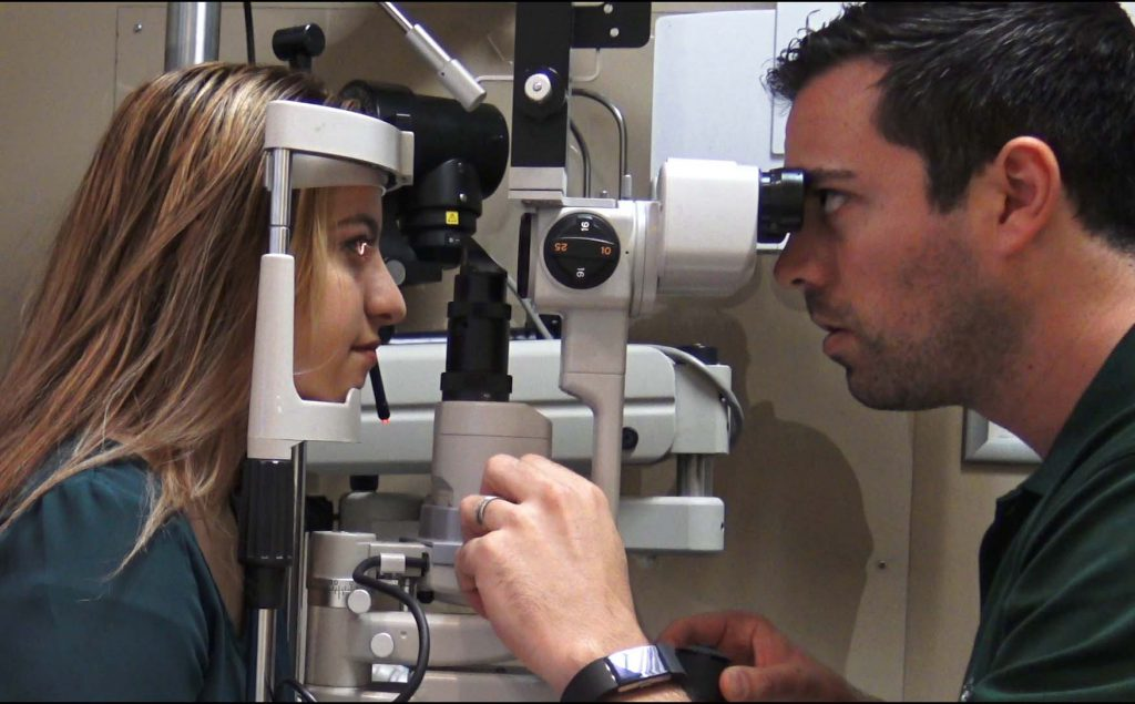 Female getting a yearly comprehensive eye exam