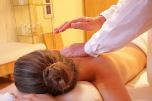 Getting frequent massages is one of many ways to avoid lower back pain from muscle tightening.