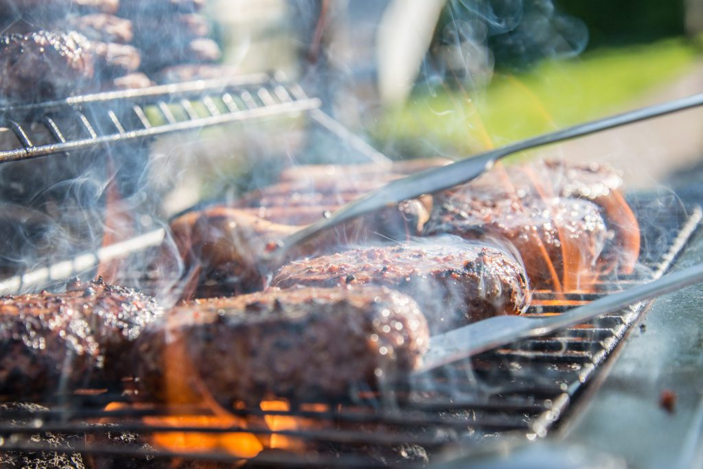 Be careful where you place raw and cooked meat when grilling
