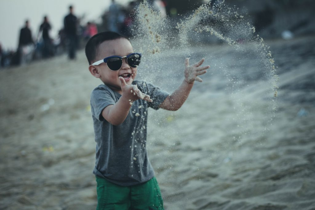 Little boy wearing sunglasses on the beach
