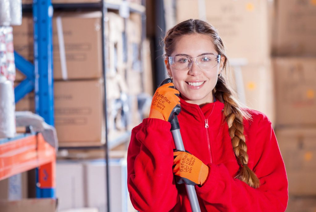 Young female wearing safety glasses at work