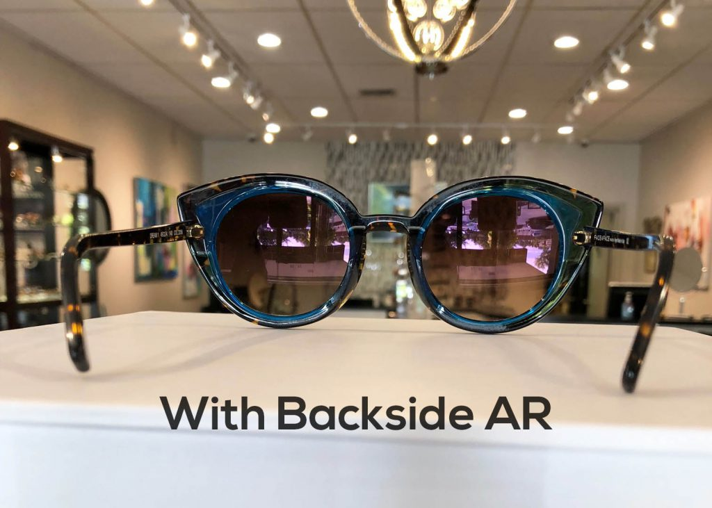 Sunglasses with a backside anti-reflective coating